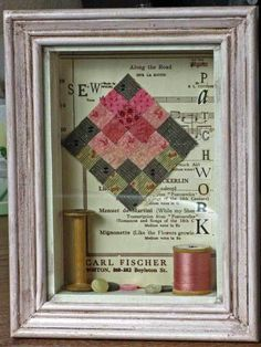 rose quilt block with spools and buttons and old sheet music.