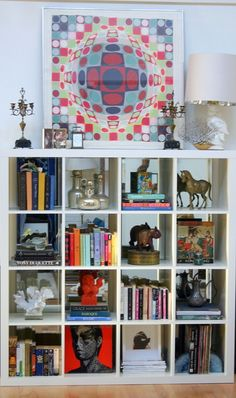 Ikea Expedit Bookcase with mirrored back styled by Design Manifest Expedit Hack, Ikea Expedit Bookcase, Cube Bookcase, Ikea Shelves, Display Shelves, Bookshelves, Ikea Hack, Ikea Kallax, Shelving