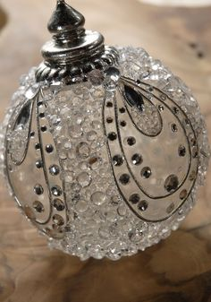 DIY ornament - image -no instructions. Clear ornament, clear drying glue, plastic crystals of various sizes- Silver backed crystals (All crystals have flat bottoms)-Silver trim/wire & decorative top