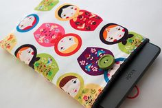 Padded Ereader sleeve for Kindle Fire, Touch, Paperwhite, etc.. $20.00, via Etsy.