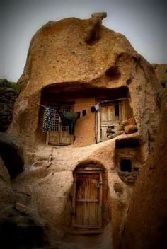 700 year old Iranian tiny homes carved out of solid stone.