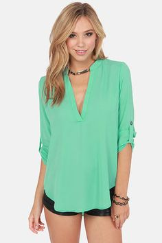 Check it out from Lulus.com! For the girl who's so on top of trends it's astounding, we see the V-sionary Mint Green Top in your future! This lightweight top pairs a silky woven material with button-tab half sleeves, a deep V-neckline, and a rounded hemline. Unlined and slightly sheer. Model is wearing a size small. 100�0Polyester. Dry Clean Only. Made with Love in the U.S.A.