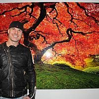Master Photographer from both the Australian Institute of Professional Photography (AIPP) and the Professional Photographers of America (PPA), Peter Lik displays his Tree of Life photo at his new gallery Lik Mandalay on February 25, 2012.