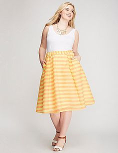 Meet the circle skirt with some serious pep in its step. Bright stripes will turn up the volume on whatever you pair it with. Pockets. Elastic waist. Fully lined. lanebryant.com