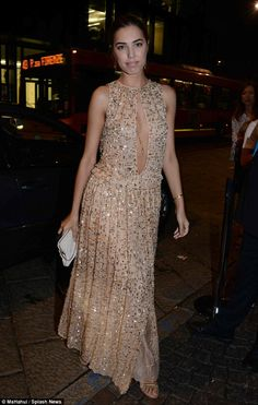 Glittering goddess: Amber Le Bon looked stunning in her nude gown featuring bronze embelli...