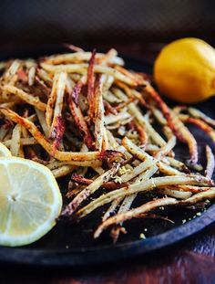 Baked Lemon Pepper French Fries - Some the Wiser.The lemon pepper adds a mildly spicy kick and a whole lot of flavor to these crunchy fries. Lemon Recipes, Potato Recipes, Good Food, Yummy Food, Tasty, French Fries Recipe, Great Recipes, Favorite Recipes, Cooking Recipes