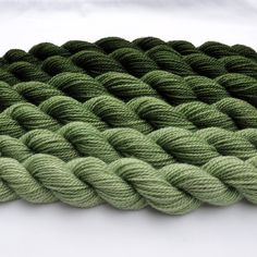 Loden Green Gradated Yarn Set. 59,10, via Etsy. Loden is a yellowish green tone heavily muted with greys.