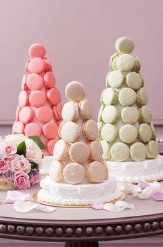 A trio of macaron pyramids in rose, vanilla and pistachio