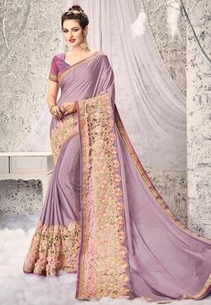 This #embroidered #Crepe #Saree brings out all the #elegance. Beautified with Resham, #Zari, #Stone and Applique work, this Light #Purple #drape is a total winner.  Product Code: SBZ3256