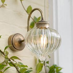 This petite new Mia wall light, in our beautifully reflective glass and metal, is IP rated for bathroom or outdoor use, so ideal for adding a designer touch to your bathroom or porch. With its on-trend, hand blown fluted glass shade showing the beauty of a vintage style bulb inside, the Mia is a contemporary classic that will suit a modern bathroom as much as a period one.