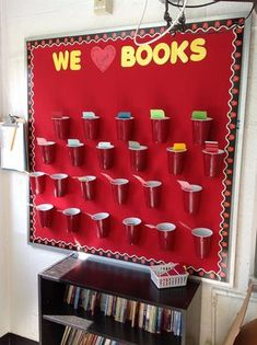 Interactive reading board: each student will fill their cup with books they read in and out of school throughout the year! Students can check out their peer cups for ideas and the teacher totals books read by class!  This picture shows cups and paint chips, but consider more visual ways to display reads. Fill your cup with knowledge!