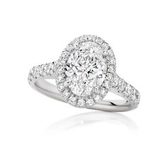 This Elegant Diamond Engagement Ring captures the perfect scintillation of brilliance set with an exceptional 1.70ct oval diamond surrounded by fine delicate round brilliant cut diamonds claw set handmade in platinum by our award winning designer jewellers. See more at http://www.armansfinejewellery.com/engagement-rings
