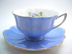 Beautiful tea cup and saucer from Shelley. Model: Blue Poppy Atholl shape. The interior of the tea cup is white with blue poppies and green leaves. The rims are highlited with gold. C. 1945 - 1966 Cup Measures: 2 3/8 high & Saucer Measures 5 5/8 diameter Excellent conditon, no chips, no cracks, no crazing and both pieces ring nicely. I try to show the true colors in my pictures however there may be slight variations between the actual pieces and the photos. These items are quite old a...