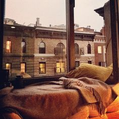 Photo by kristin_ess. Best thing to do when it rains in NY? Grab a window seat and pretend like you're Annie.