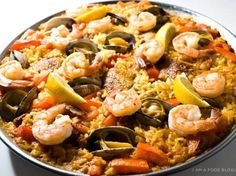 I haven't had paella in Spain, but if I ever hit up Valencia I know paella will be on my must eat list. Paella has bits of everything I love: rice, seafood, and most importantly, crispy burnt parts. Fish Dishes, Seafood Dishes, Mixed Paella Recipe, A Food, Good Food, Seafood Paella, Chicken Paella, Chicken Chorizo, Mussels