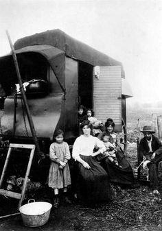 In this photo taken around 1900, gypsies in Paris pose ...