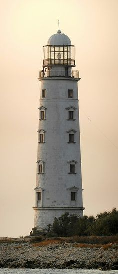 Khersonesskiy (Mys Khersonesskiy, Chersones, Sevastopol') Ukraine. 1951 (station established 1816). Active; focal plane 34 m (112 ft); white light. 36 m (118 ft) round stone tower with lantern and gallery, painted white. A 4th (?) order Fresnel lens is in use. This historic lighthouse stands on the southwest corner of the Crimean peninsula. The original lighthouse was a conical stone tower. It was replaced in 1929.
