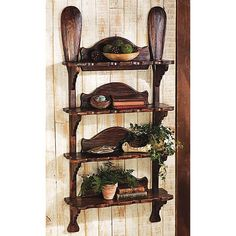 Rustic shelving and storage idea using reclaimed boat paddles