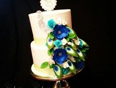 beautiful Peacock wedding cake, all covered in buttercream with fondant topper,Peacock,  feathers and flowers