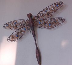 More metal from Sara. This dragonfly, which hovers on our porch, was a gift from Sara and Shaun (my future son-in-law) during our mountain vacation last August. It looks different in different light.Pretty!