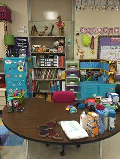 "Here is my mostly completed ""desk"" area. I don't use an actual desk, because it takes up space and this way I can have all of my materials handy while working with small groups. I still have quite a few things to put away…a teacher's job never ends! My classroom theme is giraffe and I've collected quite a few along the way."