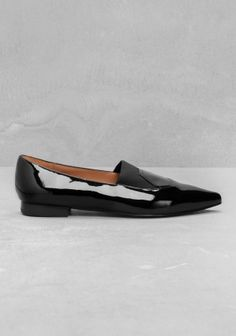 Chic ballet flats featuring a gloss-coated leather with an elastic fabric over the vamp.  -  black or blue/green.  sharp, clean.     lj