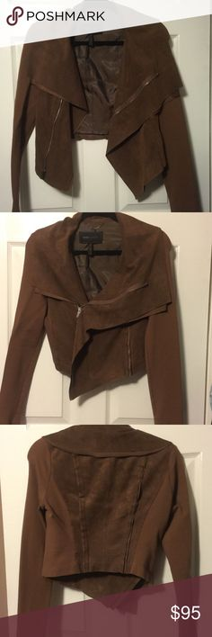On trend suede brown BCBG MAXAZRIA jacket BCBG brown suede middle section. Super chic and comfortable. Looks good open or closed. This is not a heavy jacket due to the contrasting material of the sleeves. In great condition. Size 2-4 XS BCBGMaxAzria Jackets & Coats