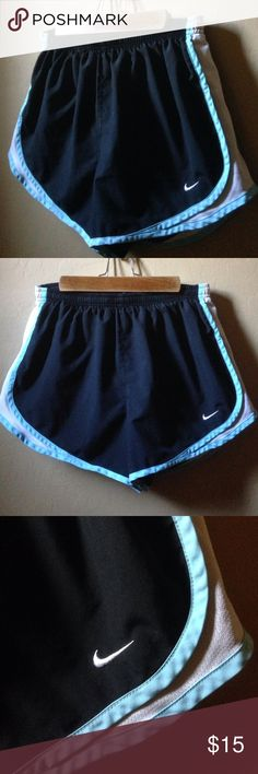 Nike Dri Fit Shorts Black with baby blue trim & white mesh in the side. Built in undergarments & has drawstring. Size medium. Nike - Just do it 👊 Nike Shorts