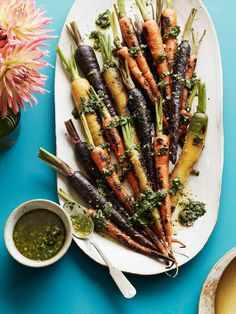 Find the recipe for this easy and colorful side dish of Charred Carrots topped with a basil mint vinaigrette at WhatsGabyCooking.com