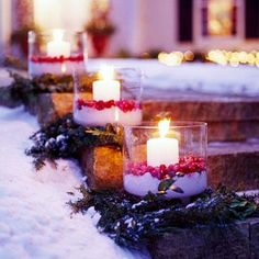Cranberry luminaria - Wide candles take shelter inside glass vases one-quarter full of Snow Wonder instant snow and topped with cranberries.