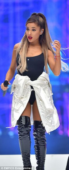 Ariana Grande puts on a racy display in leotard and silver raincoat as she takes to the stage for Capital FM's Summertime Ball | Daily Mail Online
