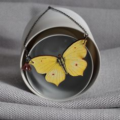 Intricate yellow wooden butterfly Necklace and Brooch from artysmartyshop.com   Handmade and hung on a gunmetal chain with a Czech glass bead.    These beautiful butterfly necklaces are made from illustrated wood and hung on a gunmetal chain and clasp with a coloured Czech glass bead. Each necklace is designed and made in the Dublin Ireland studio and comes packaged in a lovely red  box.  #jewelery #fashion #lady #accessories Butterfly Necklace, Beautiful Butterflies, Czech Glass Beads, Personalized Gifts, Jewelery, Unique Gifts, Fashion Accessories, Brooch, Dublin Ireland