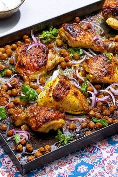 NYT Cooking: The yogurt marinade does two very important jobs in this sheet-pan chicken recipe. One, the acidity in the marinade helps tenderize the meat, and two, the sugars in the yogurt help brown and caramelize the skin of the chicken as it roasts. Be sure to toss the chickpeas occasionally as they roast to encourage them to get coated in the chicken fat as it renders.