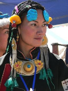 Tibetan woman with traditional jewelry. Traditional Tibetan women hairstyle (lots of braids- 108)