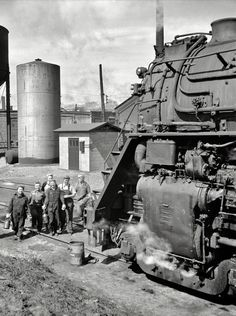 "May 1943. Clinton, Iowa. ""Women wipers of the Chicago & North Western Railroad going out to work on an engine at the roundhouse. (via Shorpy Historical Photo Archive)"