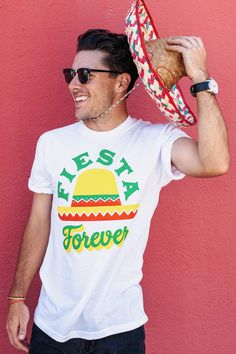 """Keep it rockin' all night long with this limited edition """"Fiesta Forever"""" t-shirt! This seasonal tee is perfect for your Cinco De Mayo party or any family feast. Grab this tee today and celebrate Mexican heritage."""