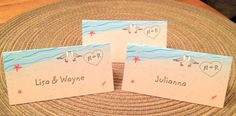 Beach wedding Placecards tent style cards with names written in sand seagulls shells starfish on Etsy, $1.00