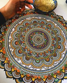 United Kingdom based artist Asmahan A. Mosleh creates beautiful mandalas.The peaces, often gilded with gold leaf, begin with a pencil outline which she then traces in pen, and finally paint. Pearl…