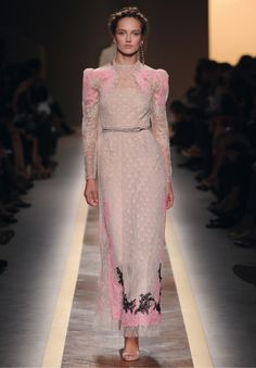 Shoulders are given structure with puff details and the waist is accentuated with a micro-studded belt.