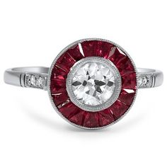 This matchless platinum Art Deco ring features an old European cut center diamond surrounded by fourteen vivid French cut lab-created rubies in a gorgeous round bezel halo. Available in Platinum. Antique Engagement Rings, Antique Rings, Diamond Engagement Rings, Antique Jewelry, Vintage Jewelry, Vintage Art, Art Deco Ring, Brilliant Earth, Diamond Are A Girls Best Friend