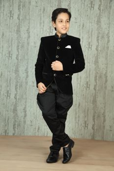 Black velvet jodhpuri suit in checks embellished with stud work with polo pants. Item number KB16-01