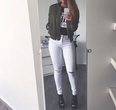 White jeans, b&w top, green bomber