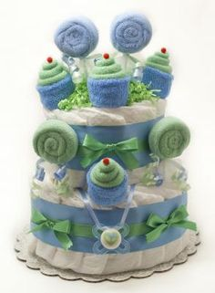 """2 Tier Sweet Treat Cake is made with: * 32-34 Pampers Swaddlers size 1 diapers * 8 baby washcloths * 2 pairs of socks * pacifier * decorative ribbon * hand tied bow * crinkle paper The cake rest on a  10"""" cake board and is 12"""" tall. Diaper cake comes in a cellophane bag with matching bow. Ready for gift giving!!!  Thanks for looking!!!"""