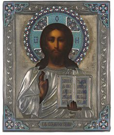 CHRIST PANTOKRATOR -  RUSSIAN, MAKER'S MARK S.G. IN CYRILLIC, 1894 -  Represented frontal, half-length, blessing and bearing the Book of Gospels, painted realistically with warm colours, the silver oklad with traces of gilding, the border with repoussé foliate patterns, the inscriptions in champlevé enamel, the cut-out halo and spandrels in polychrome cloisonné enamel 10½ x 8¾ in. (27.7 x 22.2 cm)