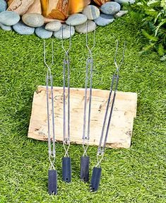 "This must-have Set of 4 Extendable BBQ Forks helps you make the most of your summer cooking by making it easy to roast food over an open flame. Each fork has a plastic handle and extends so you can cook at a safe distance. 1-1/4""W x 22-1/4""L, extending u"