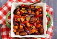 Paleo Chop & Drop Roasted Veggies & Sausage Recipe   Paleo Newbie {Update: Delish! Made with the following veggies: 1 white flesh sweet potato, 1 green zucchini, 1 large carrot, 1 red bell pepper, 1 green bell pepper, 1/2 red onion, 1 pkg spicy Italian sausage (uncooked).  -KC}