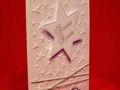 """Cartes de voeux blanches, les étoiles de fond sont embossées à froid et les étoiles """"Bonne année"""" en relief sont réalisées avec la silhouette caméo. J'ai réalisé une série en doré et une autre en argenté."""