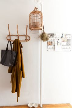 Bird cage and coat hooks