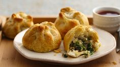 In an easy take on traditional pork dumplings, the tasty filling is baked in a biscuit wrapper.