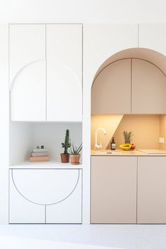 This Tiny Home in Paris Unfolds Like a Children's Pop-Up Book - Photo 2 of 11 - The redesign includes bespoke cabinetry which conceals a hidden dining table and stools, as well as a small fridge.